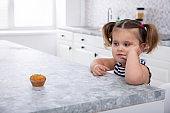 Pretty Girl Looking At Cupcake