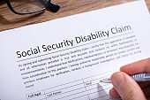 Person Filling Social Security Disability Claim Form