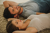 Couple lying on the floor together and relaxing