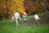 Rear view of family going on a walk in the autumnal park