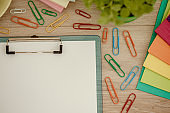 Clipboard with blank paper, paper clips and files