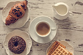 Donut, waffles, croissants and coffe