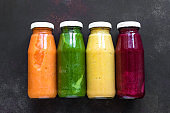 Colourful smoothies bottles