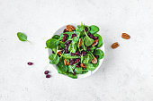 Spinach salad with pecan nuts, dry cranberries
