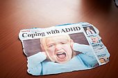 """""""Coping with ADHD"""" headline illustrated by screaming little girl"""