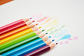 Nine colored pencils draw tiny flowers