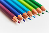 Row of sharpened pencil crayons in cropped close-up