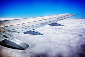 Passenger airplane flying over dramatic expanse of cloud