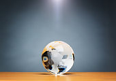 Spherical glass paperweight on wooden surface