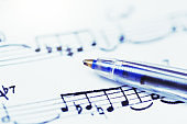Sheet music with ballpoint pen resting on it