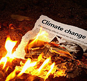 """""""Climate change"""" headline in flaming newspaper"""