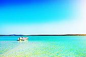 Speedboat moored on the water in a beautiful idyllic lagoon