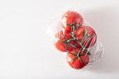 single use plastic packaging issue.tomatoes vegetables in plastic bag