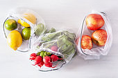 fruits and vegetables in reusable mesh nylon bag, plastic free zero waste concept