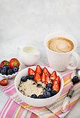 Healthy breakfast with oatmeal porridge, fresh berries and coffee