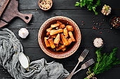 Potatoes fried with garlic. Ukrainian Traditional Cuisine. Top view. Free space for your text. Rustic style.