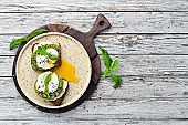 Sandwich with Philadelphia cheese, avocado and egg. Top view. Free space for your text. Rustic style.