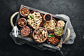 Set nuts and dried fruit in a wooden box. Top view. Free space for your text.