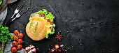 Burger with cheese, tomatoes and onion. Breakfast. Top view. Free space for your text.