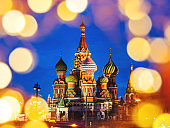 Famous landmark - St. Basil Cathedral on Red square in Kremlin. Light bulbs bokeh. Moscow, Russia.