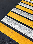Pedestrian zebra crossing. Road markings on the asphalt. Painted signs on the roadway and pedestrian crosswalk.
