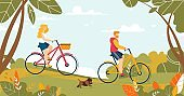 Man and Woman Couple Riding Bicycle in Forest