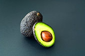 Avocado ready to eat on dark background. Healthy eating concept.