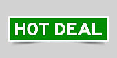 Green and white sticker with word hot deal on gray background