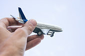 small toy plane in the hands