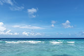 Crystal-blue sea and blue sky background