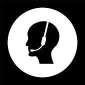 Operator in headset  - black vector icon