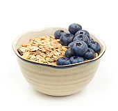 Blueberry and   Oatmeal in a   bowl  isolated on white background.