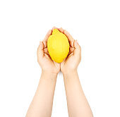 Female hand holding cup and Lemon on a white background