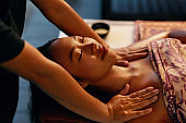 Spa Massage. Woman Getting Traditional Thai Body Care Therapy