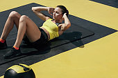 Fitness woman doing sit-ups exercise workout at gym. Sport