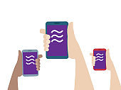 hands holding mobile smartphone with libra coin