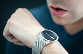 Voice recording or speech recognition technology in smart watch. Man talking to smartwatch mic and recorder. Personal assistant app to give command or send message.
