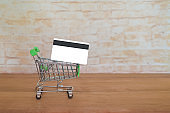 Credit card or debit card on trolley ,shopping concept.