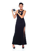 Full length / one person / front view of 20-29 years old adult beautiful african ethnicity / african-american ethnicity female / young women photographer / photography in front of white background wearing dress who is smiling / happy / cheerful