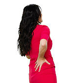 Rear view / back / one person / waist up / portrait of adult beautiful black hair / long hair caucasian female / young women standing / bending over / physical injury wearing dress / cool attitude with backache / bad posture