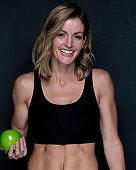 Beautiful sports woman on black background