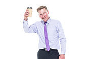 One person / front view / waist up of 20-29 years old adult handsome people caucasian male / young men business person / businessman / manager standing wearing necktie who is smiling / happy / cheerful and holding coffee cup