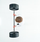 Directly above view of man in dress shirt lifting weights