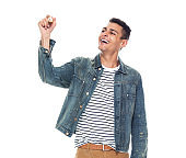 One person / front view / waist up of 20-29 years old adult tall person / handsome people african ethnicity / african-american ethnicity male / young men standing in front of white background wearing denim jacket who is smiling / happy / cheerful