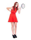 Beautiful female in red dress holding a megaphone
