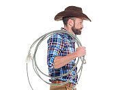 One man only / one person / waist up / side view / profile view of 30-39 years old adult handsome people brown hair / with beard / short hair caucasian male / young men cowboy standing who is serious / confidence / concentration / cool attitude