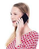 One person / side view / waist up of 18-19 years old adult beautiful caucasian female / young women teenage girls standing in front of white background wearing dress who is talking / smiling / happy / cheerful / cool attitude and holding mobile phone