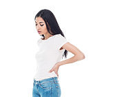 One person / waist up of 20-29 years old adult beautiful / long hair latin american and hispanic ethnicity female / young women standing / physical injury in front of white background wearing t-shirt / shirt who is in pain / illness / cool attitude