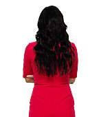 Rear view / back / one person / waist up / portrait of adult beautiful black hair / long hair caucasian female / young women standing wearing dress who is confidence / cool attitude with arms crossed