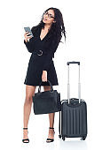 One person / full length of 18-19 years old beautiful black hair / curly hair latin american and hispanic ethnicity young women / female business person / businesswoman in front of white background wearing dress who is smiling / happy / cheerful